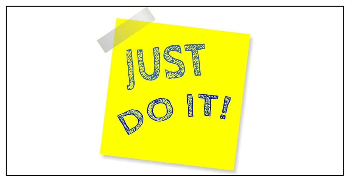 "Yellow sticky note with ""Just do it"" to achieve your goal"