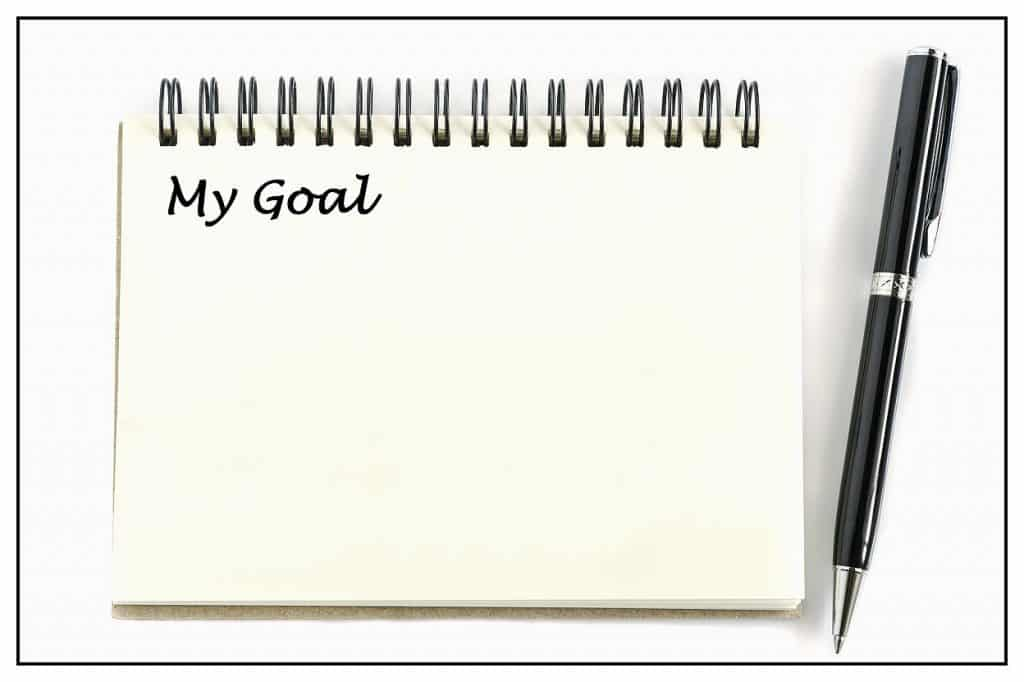 Notepad with My Goal title with pen to show setting goals