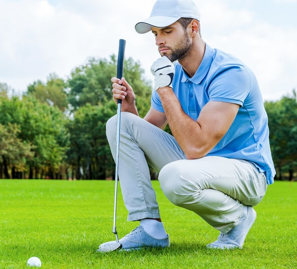 Kneeling golfer controlling mental game